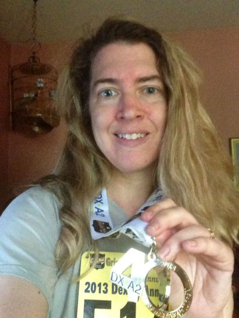 I earned this finishers' medal at the Dexter-Ann Arbor 10 K this past weekend. Yay!