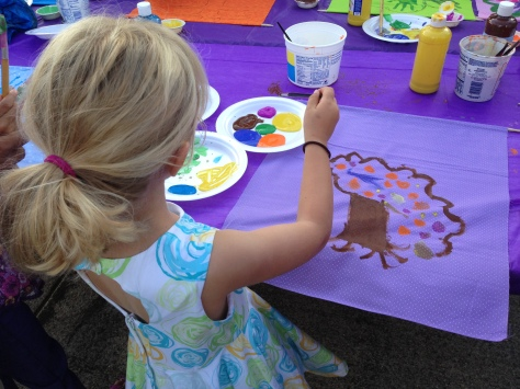 "Lily making a ""family tree"" banner at a school picnic, where - wait for it - I got MORE forms that I didn't read until the night before her first day of kindergarten. Mommy FAIL."