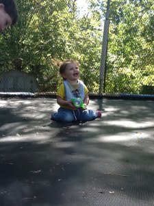 Neve enjoying herself on the trampoline last summer, in 2012.