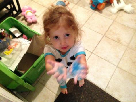 "Neve, after she recently squished a Smurf. (Or colored her hands in ""washable"" blue marker. One of those.)"