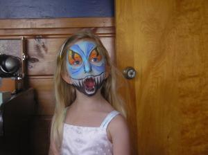 Lily picked a scary monster face paint design while wearing a pink dress. I loved the contrast.